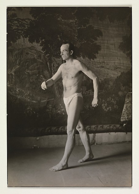 [Man in Briefs, Walking before Tapestry, Germany]