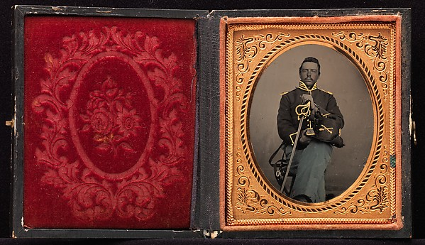 [Union Cavalry Officer Displaying Sword, Holding Hat, Seated in Studio]
