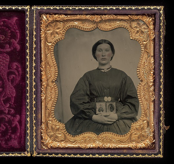 [Woman Holding Cased Portraits of Civil War Soldiers]