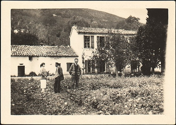 [Lucien Jacques, Georgette Maury, and Léon Berthier Standing in Garden in Front of French Country-Style House, Cyprés de St. Jean par Grasse, France]