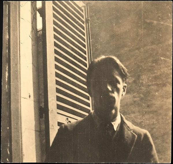 [Self-portrait in Window, 5 rue de la Santè, Paris]
