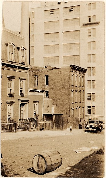 [Exterior View of Apartment Building at 48 Columbia Heights with Barrel in Foreground, Brooklyn, New York]