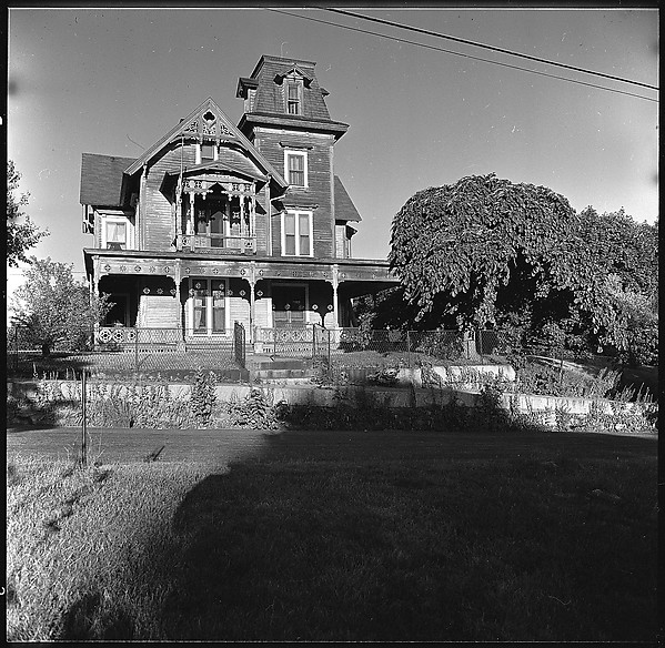 [9 Exterior Views of Victorian House with Photographer's Shadow in Foreground]