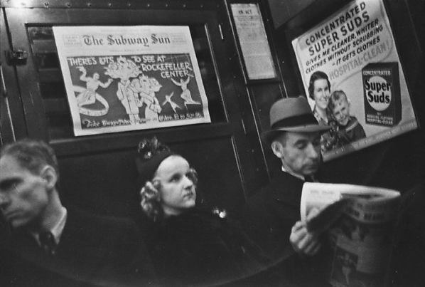 [Subway Passengers, New York City: Young Woman, Two Men]