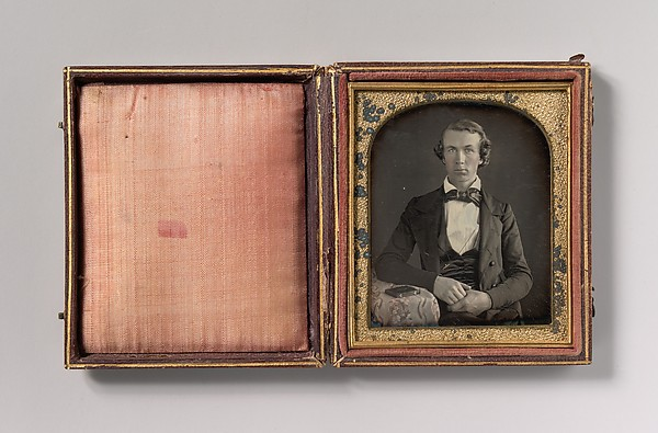 Fascinating Historical Picture of Unknown with [Seated Young Man Resting Arm on Table Beside Daguerreotype Case] in 1840