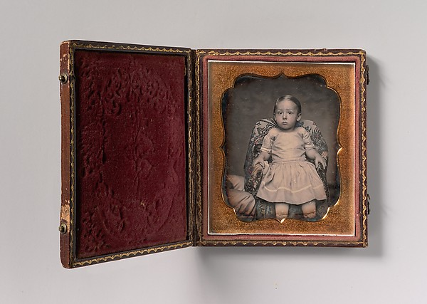 Fascinating Historical Picture of Unknown with [Child Sitting on Chair Draped with Floral Print Fabric] in 1850