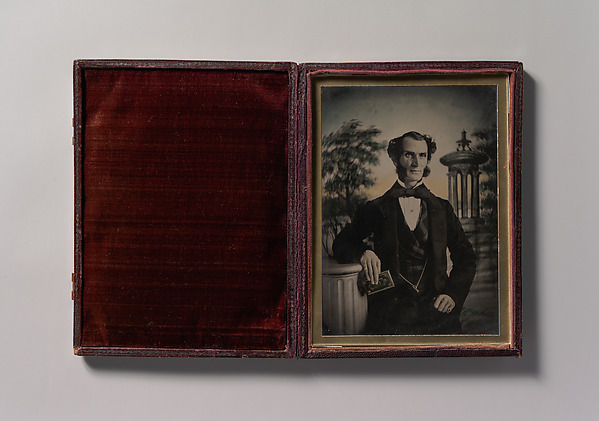 Fascinating Historical Picture of Unknown with [Man Holding Book Standing Before a Painted Scenic Backdrop] in 1850