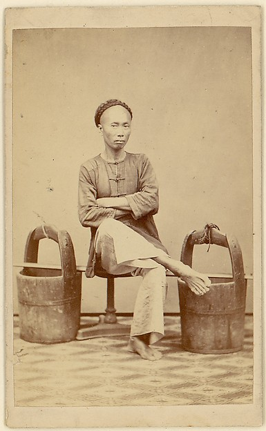 [Man with Buckets]