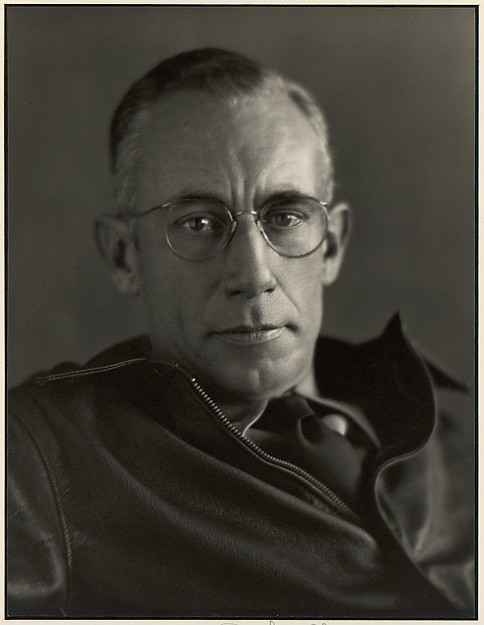 [Man with Wire-rimmed Glasses]