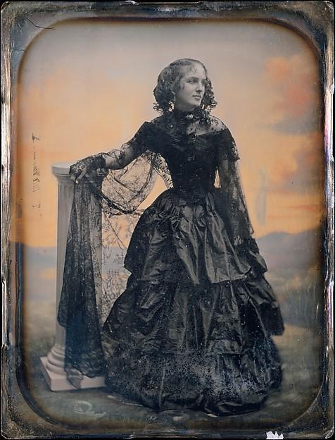 [Woman in Black Taffeta Dress and Lace Shawl]