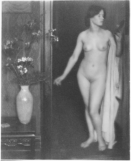 [Female Nude Standing in Doorway with Small Mirror in Hand]