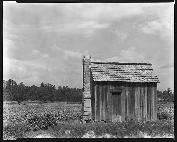 [Wooden Shack in Field]