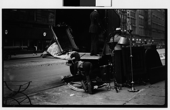 [Moving Truck on Street with Mirror, Hobby Horse, and Lamp on Sidewalk, New York City]
