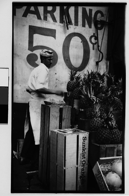 [Worker Unloading Pineapples from Crates, New York City]