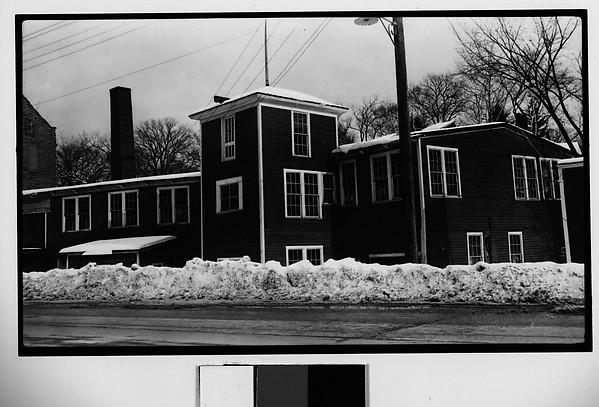[Wooden Clapboard Building Behind Snow Bank]