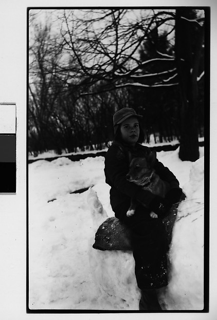 [Child, Possibly Mabry Girl, Holding Dog in Snow]