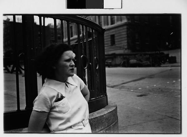 [Woman Standing on Street]