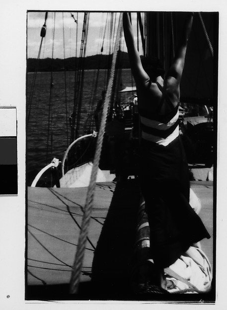 [South Seas: Isabelle Jennings With Upraised Arms on Cressida Deck, From Behind]