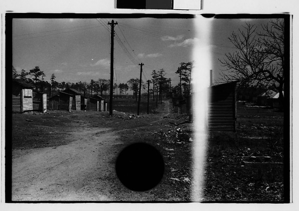 [Wooden Shacks on Dirt Road, Southeastern U.S.]