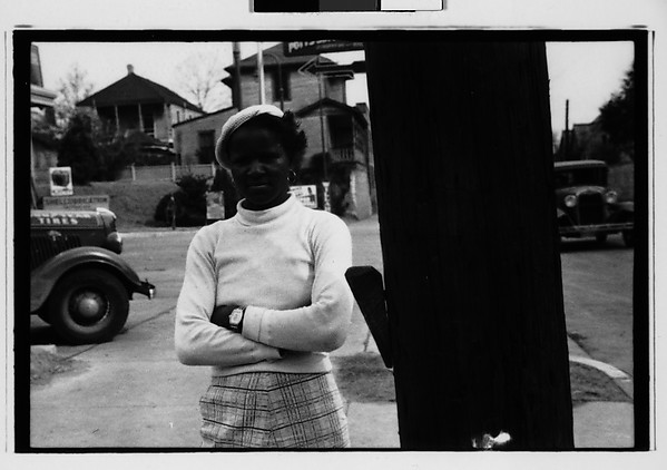 [Woman in Filling Station Lot, Vicksburg or New Orleans]