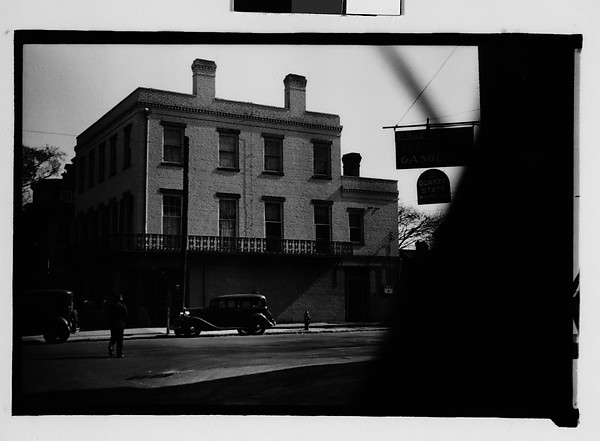 [Flat-Roofed Brick Building with Parked Car on Street, From Automobile, Savannah, Georgia]