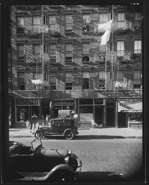 [Apartment Building with Ground Floor Shops and Parked Cars in Front, 41-43 Carmine Street, New York City]
