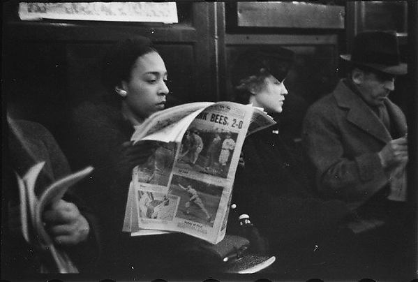 [Subway Passenger, New York City: Woman in Fur Collar Reading Newspaper]