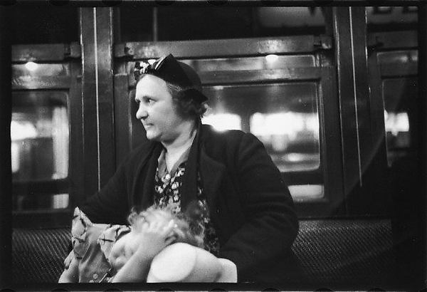 [Subway Passengers, New York City: Mother with Daughter on Lap]