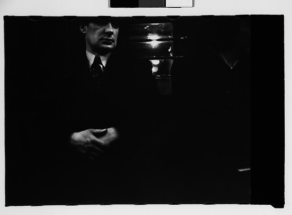 [Subway Passenger, New York City: Man in Suit]