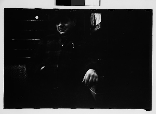 [Subway Passengers, New York City: Man in Hat and Plaid Workcoat]
