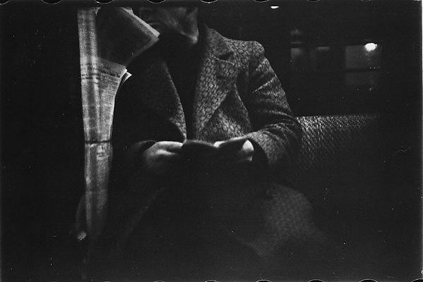 [Subway Passenger, New York City: Man Reading]
