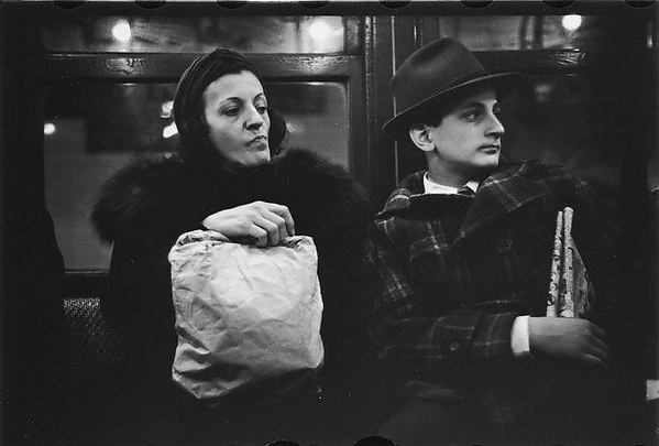 [Subway Passengers, New York City: Woman with Package on Lap, Man]