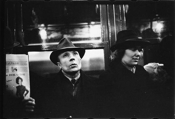 [Subway Passengers, New York City: Man in Hat Next to Woman]