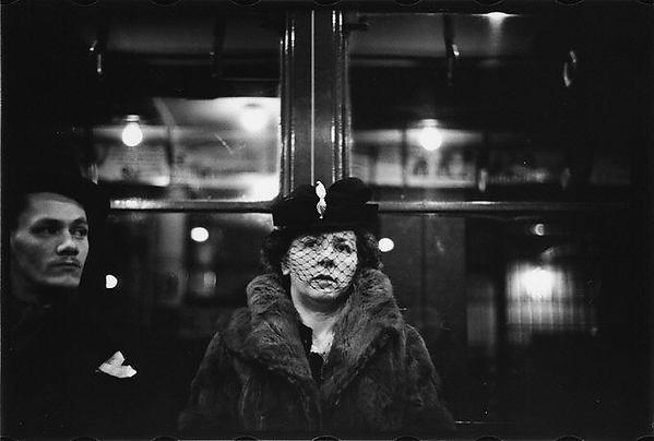 [Subway Passengers, New York City: Man, Woman]
