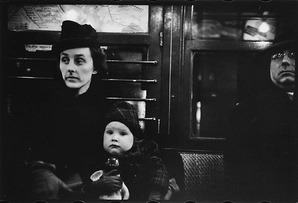 [Subway Passenger, New York City: Mother with Child on Lap]