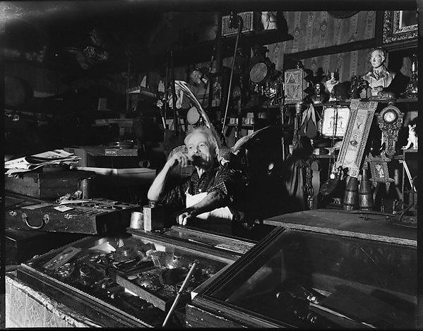 [Junk Shop Owner with Parrot on Shoulder, Williamsburg, Brooklyn]