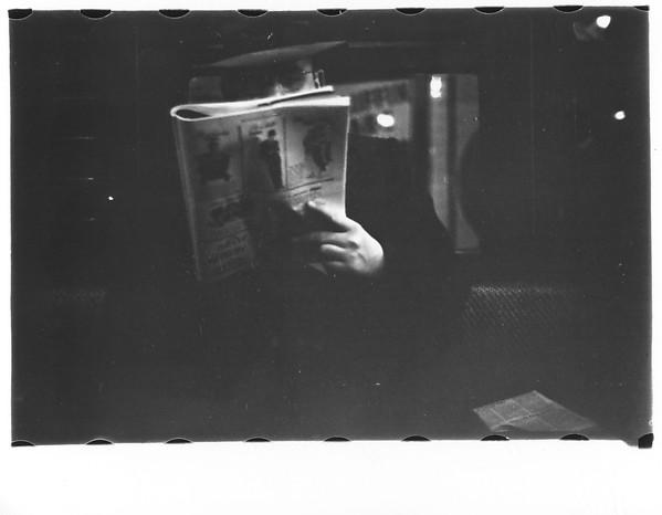 [Subway Passenger, New York City: Man Reading Newspaper]