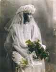 [Seated Bride Holding Spray of Ferns]