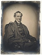 [Man in Judge's Robes; Seated]