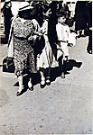[Pedestrians, New York City: Woman, Girl, and Boy in Line and Looking to the Left]