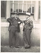 [Two Businessmen in Hats Talking on Street, Florida]