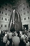 "[Lette Eisenhauer Descending from Giant ""Mountain"" Construction, After Performance of ""The Courtyard,"" A Happening by Allan Kaprow, New York City]"