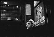 [Subway Passenger, New York City: Sailor Beneath Chesterfield Cigarette Advertisement on Times Square Shuttle]