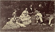 [Group Portrait of Four Women, Two Men and Three Children in a Garden]