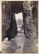 [View Through Rocks' Of Tower On Hill]