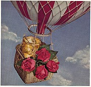 [Still-life of Four Roses, Glass of Bourbon, in a Hot Air Balloon Basket]