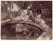 [Elderly Man and Young Boy at Garden Fountain, Sicily, Italy]