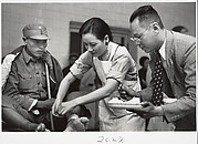 Mme. Chaing Kai-shek caring for the wounded. Hankow