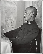 Chaing Kai-shek presides over his Supreme War Council just prior to the departure of the twenty-eight German advisors who had been instrumental in training his army. Hankow, July 4