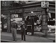 [Two Men on Street before a Corner Cafe, Oregon]